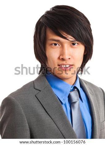Handsome Chinese young businessman portrait - stock photo