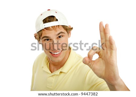 Handsome college age young man giving A okay sign for success.  Isolated on white.