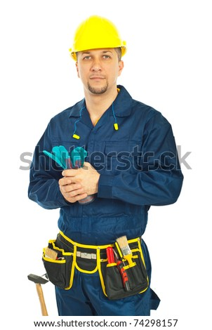 Handsome constructor worker holding gloves isolated on white background