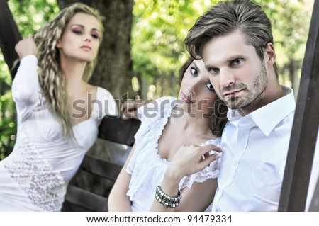 Handsome couple and his friend - stock photo