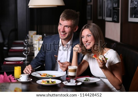 Handsome couple having lunch