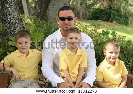 Handsome dad with happy boys