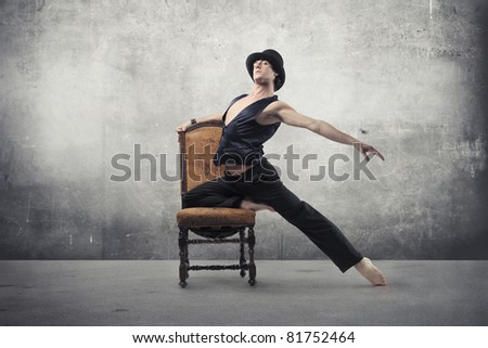Handsome dancer on a chair