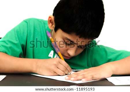 Handsome diligent kid doing his home work