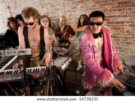 Handsome DJs playing music at a 1970s Disco Music Party