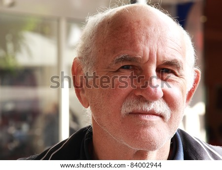 handsome elderly man in the street. portrait