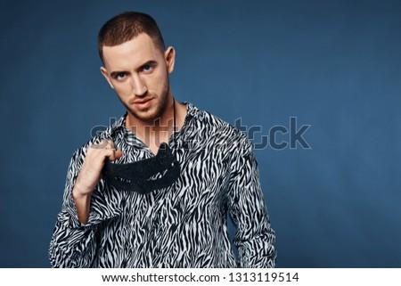 Handsome elegant men black white shirts with short hair model appearance on a blue background