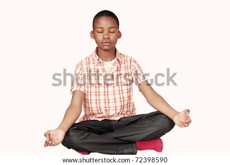 Handsome ethnic youth in yoga meditation pose