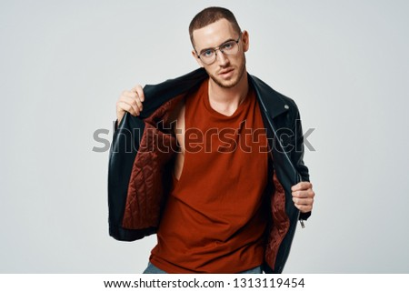 107d9a2ae9be ... street style outdoor portrait. handsome fashionable man in a black  leather jacket with a naked body in a black hat