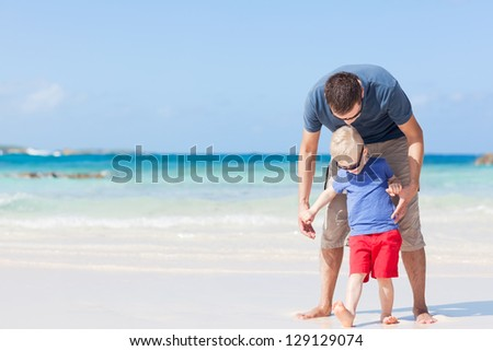 handsome father and his son at the caribbean beach