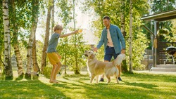 Handsome Father and Son Spend Quality Family Time Together, Play Soccer with Football, Passing to Each other, and Having Fun. Sunny Day Idyllic Suburban Home Backyard with Loyal Golden Retriever Dog