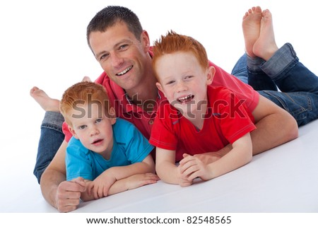 Handsome father with his happy playful sons