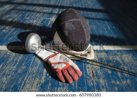 Handsome fencer prepares for competitions and a training. Fencer stand with sword and mask. Fencer with sword. Sword. Men with sword. Fencing. Training. Motivation. Sport. Sport man, Young man