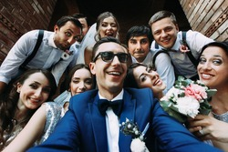 Handsome groom selfie with fun beautiful bridesmaids & groomsmen