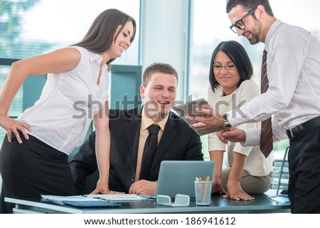 Handsome group of business people working #186941612
