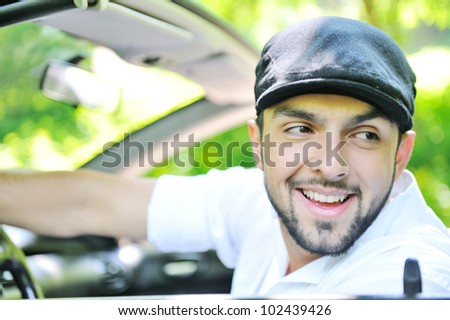 Handsome guy in a car smiling