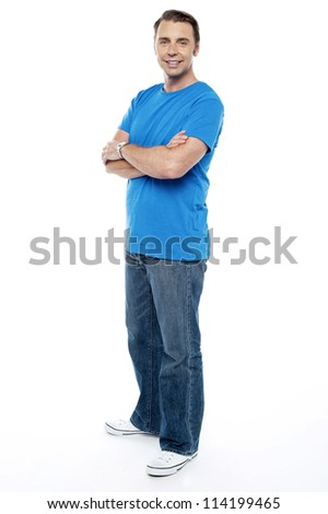 Handsome guy keeping his arms crossed, casual shot on white background