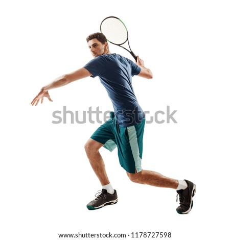 Handsome guy playing tennis, isolated on white. Big swing of a racket before the forehand stroke.