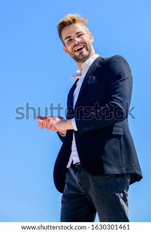 Handsome guy posing in formal suit blue sky background. Office worker. Ready to work. Male fashion. Formal style. Confident handsome businessman. Handsome man fashion model. Looking impeccable.