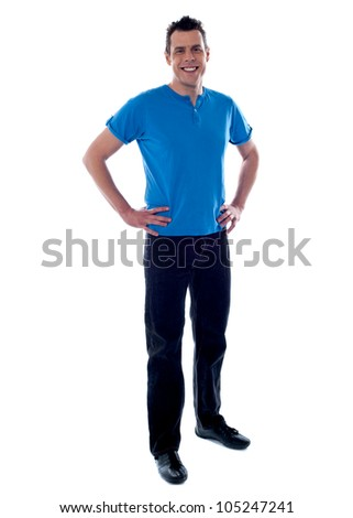Handsome guy posing with hands on his waist wearing casuals