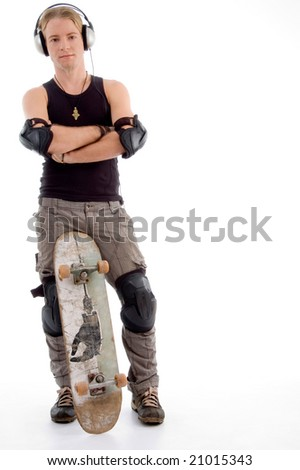 handsome guy posing with skateboard against white background
