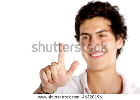 Handsome guy touching an imaginary screen isolated on white