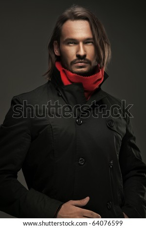 Handsome guy wearing autumn clothes - stock photo
