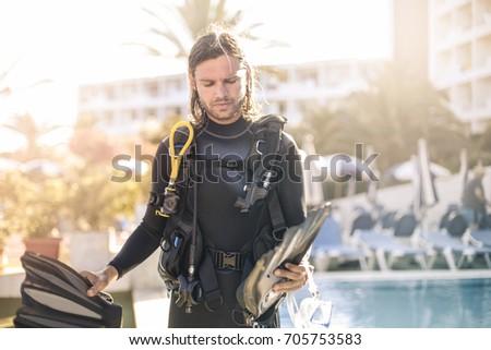 Handsome guy wearing scuba diver's equipment #705753583