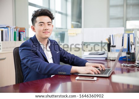 handsome handsome chinese man, owner of a company
