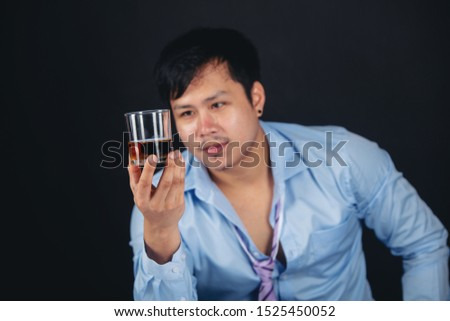 Handsome handsome man drinking whisky at home