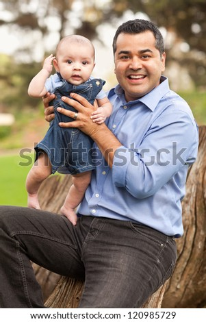 Handsome Hispanic Father and Son Posing for A Portrait in the Park.
