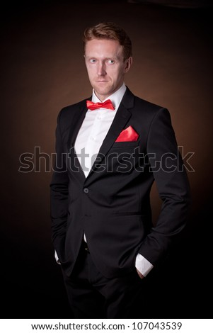 ec167891bd00 Portrait of a young man in black suit and red bow-tie. Images and ...