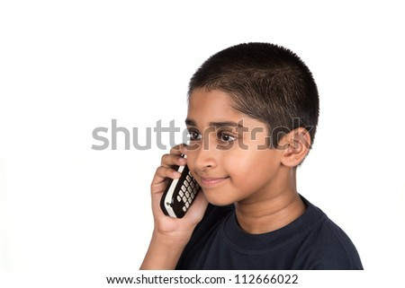 Handsome Indian kid looking very happy talking on phone