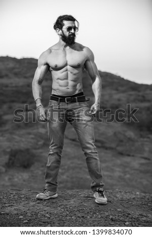 Handsome indian muscled fit male model man posing outdoor showing his abdominal muscles black and white - Image