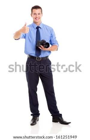 handsome journalist giving thumb up isolated on white