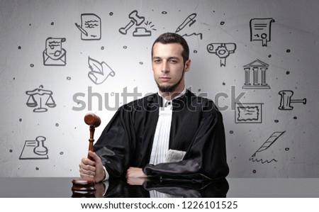 Handsome judge with court symbols around