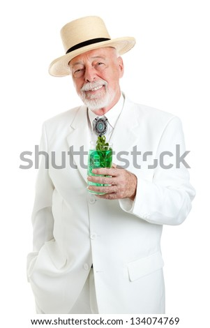 Handsome Kentucky colonel or Southern gentleman drinking a mint julep for Derby Day.  Isolated on white.