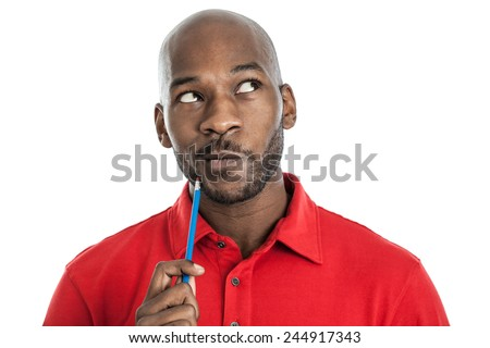 Handsome late 20s black man with pencil on chin thinking isolated on a white background #244917343