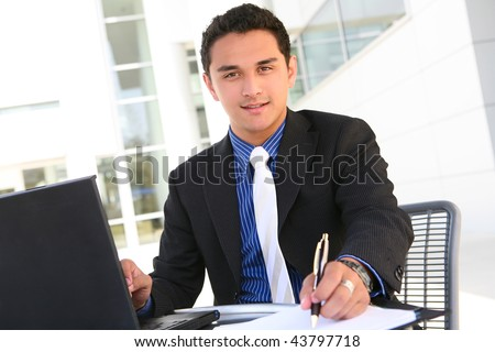 Handsome Latino Business Man at Office Working
