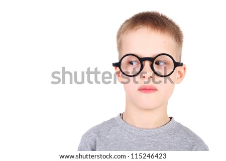 handsome little boy in the round glasses looking to the left