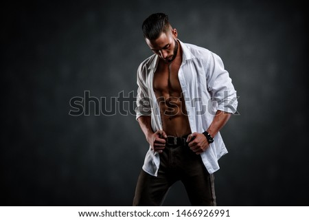 Handsome Male Model Wearing Unbuttoned White Shirt Exposing His Muscular Torso