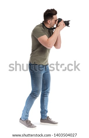 Handsome male photographer on white background