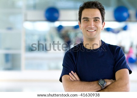 Handsome male portait at the gym smiling