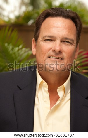 Handsome Male Portrait with Sport Coat in the Outdoors.