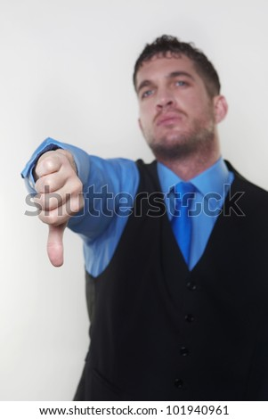 handsome male with his thumb down shoot in the studio