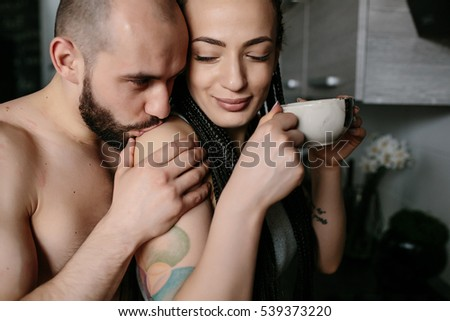 handsome man and beautiful woman posing in the kitchen #539373220