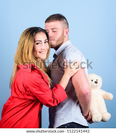 Handsome man and pretty girl in love. Man and woman couple in love. Romantic surprise. Valentines day holiday. Surprise for sweetheart. Soft toy teddy bear gift. Surprise gift concept. Surprising her.
