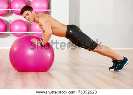 Handsome man at the gym doing exercises
