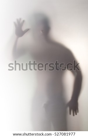 handsome man behind a screen, Blurry shadow #527081977