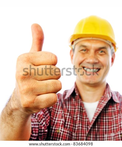 handsome man builder smiles and shows OK gesture with his hand